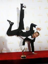 "Derek Hough poses with his outstanding choreography award for ""Dancing with the Stars"" that he won along with Julianne Hough and Tessandra Chavez, backstage at the 2015 Creative Arts Emmy Awards in Los Angeles, California, September 12, 2015. (Credit: REUTERS/Danny Moloshok )"